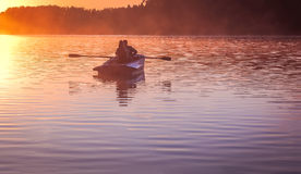Romantic golden sunset river lake fog loving couple small rowing boat date beautiful Lovers ride during Happy woman man together r Stock Photography