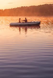 Romantic golden sunset river lake fog loving couple small rowing boat date beautiful Lovers ride during Happy woman man together r Royalty Free Stock Photos
