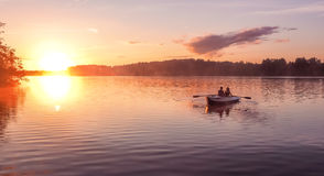 Romantic golden sunset river lake fog loving couple small rowing boat date beautiful Lovers ride during Happy woman man together r Stock Photo