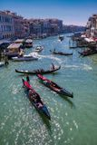 Romantic gondola ride in the canals of Venice, Italy stock photography