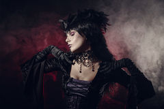 Romantic gothic girl in Victorian style clothes. Shot over smoky background Royalty Free Stock Image