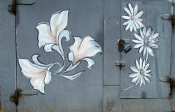 Romantic graffiti. Romantic flower graffiti on the steel doors of a garage Royalty Free Stock Photography