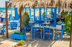 Romantic Greek restaurant with blue chairs, Greece Royalty Free Stock Images