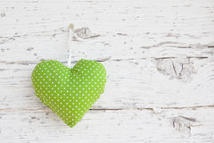 Free Romantic Green Dotted Heart Shape Hanging Above White Wooden Surface On A Nail- White Wooden Shabby Chic Background For Royalty Free Stock Image - 35002436
