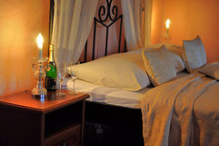 Romantic guest bedroom. Romantic guest room with flowers and champagne Royalty Free Stock Photography