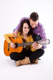 Romantic guitar couple Stock Photos