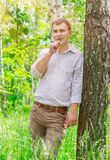 Romantic guy in the park Royalty Free Stock Photography