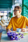 Romantic Guy Waiting for Date in Cafe Stock Photo