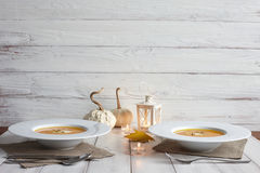 Romantic halloween dinner with pumpkin soup stock photography