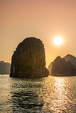 Romantic Halong bay sunset over limestone rocks, Vietnam Royalty Free Stock Images