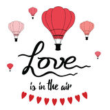 Romantic hand drawn slogan Love is in the air decorated hot balloons, hearts. Wedding banner or St. Valentine`s Day card. Heart brush on swatch Stock Photo