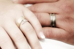 Romantic hands with wedding ri Stock Images