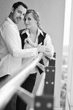 Romantic happpy couple on balcony. Romantic happy couple relax and have fun at balcony in their new home apartment Royalty Free Stock Image