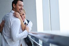 Romantic happpy couple on balcony. Romantic happy couple relax and have fun at balcony in their new home apartment Stock Photo