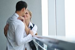Romantic happpy couple on balcony. Romantic happy couple relax and have fun at balcony in their new home apartment Stock Image