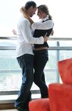 Romantic happpy couple on balcony. Romantic happy couple relax and have fun at balcony in their new home apartment Stock Photos