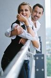 Romantic happpy couple on balcony. Romantic happy couple relax and have fun at balcony in their new home apartment Stock Images