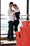 Romantic happpy couple on balcony. Romantic happy couple relax and have fun at balcony in their new home apartment Royalty Free Stock Photo