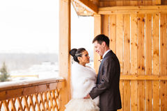Romantic happy bride and groom on winter wedding day Stock Image