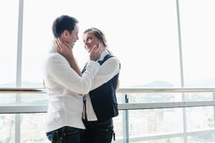 Romantic happy couple on balcony. Romantic happy couple relax and have fun at balcony in their new home apartment Stock Images
