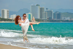 Romantic happy couple on the beach Stock Images