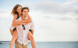 Romantic happy couple on the beach at sunset Royalty Free Stock Photography