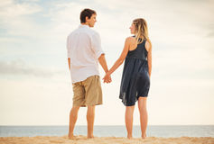 Romantic happy couple on beach at sunset Royalty Free Stock Photography