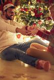 Romantic happy couple celebrating Christmas and having fun royalty free stock images