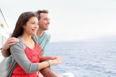 Romantic happy couple on cruise ship traveling. Romantic happy couple on cruise ship on boat travel embracing looking at view. Happy lovers traveling on vacation Royalty Free Stock Photo
