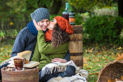 Romantic happy couple at fall. Couple kissing in autumn garden stock photography