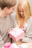 Romantic happy couple with gift in the cafe Royalty Free Stock Photo