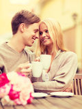 Romantic happy couple kissing in the cafe Stock Photography
