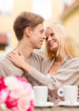 Romantic happy couple kissing in the cafe Royalty Free Stock Photo