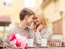 Romantic happy couple kissing in the cafe Stock Images