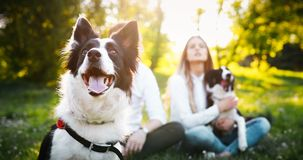 Romantic happy couple in love enjoying their time with pets in nature Stock Image