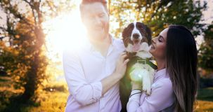 Romantic happy couple in love enjoying their time with pets. In nature Royalty Free Stock Images