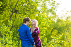 Romantic happy couple in love on nature. Man and woman hugging in summer park. Romantic happy couple in love on nature. Man and women kissing in summer park Royalty Free Stock Photos