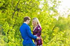 Romantic happy couple in love on nature. Man and woman hugging in summer park. Romantic happy couple in love on nature. Man and women kissing in summer park Royalty Free Stock Image