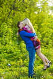 Romantic happy couple in love on nature. Man and woman kissing in summer park. Romantic happy couple in love on nature. Man and women kissing in summer park Stock Photography