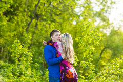 Romantic happy couple in love on nature. Man and woman kissing in summer park. Romantic happy couple in love on nature. Man and women kissing in summer park Stock Image