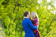 Romantic happy couple in love on nature. Man and woman kissing in summer park. Romantic happy couple in love on nature. Man and women kissing in summer park Stock Photo
