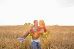 Romantic happy couple on nature at sunset, man and woman in love stock photos
