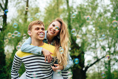 Romantic happy loving couple on nature in spring. 1 royalty free stock image