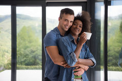 Romantic happy young couple relax at modern home indoors Stock Image