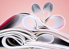 Romantic heart of magazines on a red background Royalty Free Stock Photography