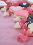 Romantic heart shape pink, white and black cookies and candy Royalty Free Stock Photos