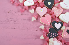 Romantic heart shape pink, white and black cookies and candy Stock Photography