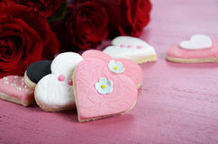 Romantic heart shape pink, white and black cookies with roses Stock Images