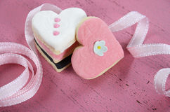 Romantic heart shape pink, white and black cookies Royalty Free Stock Images