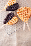 Romantic heart shaped waffle lollipops Royalty Free Stock Photography